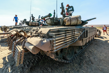 KADAMOVSKIY TRAINING GROUND, ROSTOV REGION, RUSSIA, 26 AUGUST 2017: International military technical forum ARMY-2017. Young visitors of the exhibition inspect the tanks T-72 Editorial