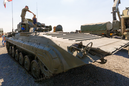 KADAMOVSKIY TRAINING GROUND, ROSTOV REGION, RUSSIA, 26 AUGUST 2017: International military technical forum ARMY-2017. Soldier shows visitors the mobile reconnaissance post PRP-4A