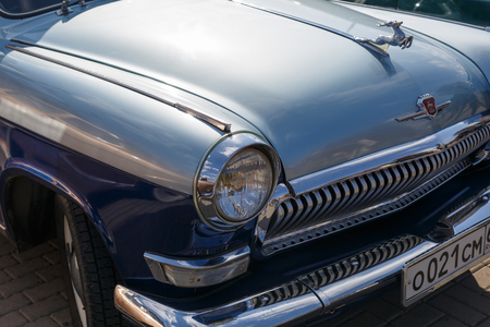 RUSSIA, ROSTOV-ON-DON, 07 OCTOBER 2017: GAZ-21 Volga front part of the middle blue color car close-up