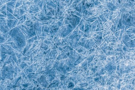 Un sacco di ghiaccioli blu taglienti come sfondo o sfondo Archivio Fotografico