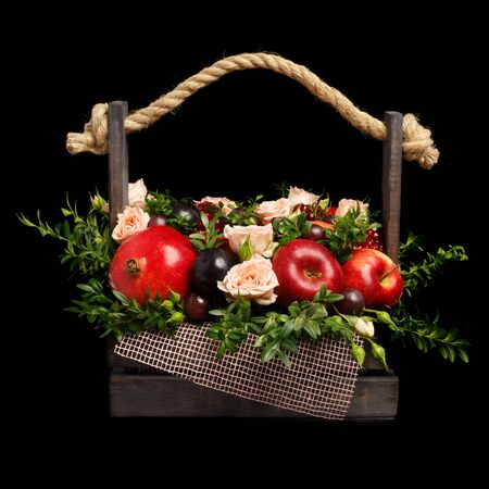 Roses and fruits in wooden box