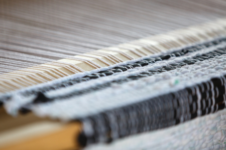 Wooden loom as an equipment for manual fabric manufacture. Close-up