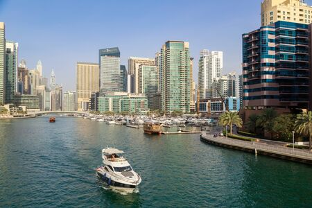 DUBAI, UAE, JANUARY 08, 2019: Motor yacht sails on the bay Redactioneel