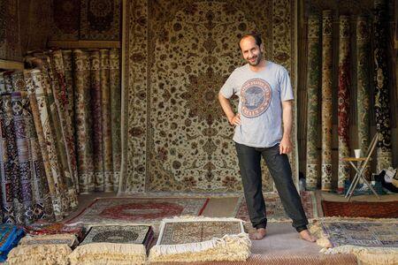 DUBAI, UAE, JANUARY 12, 2019: Carpet seller welcomes buyers