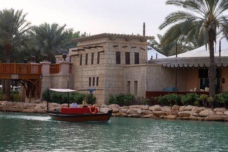 DUBAI, UAE, JANUARY 13, 2019: Tourists rest in arabic boats in Madinat Jumeirah