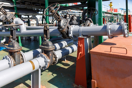 Gate valves and pipelines for loading and discharging liquid cargo on oil-chemical tanker Stock Photo