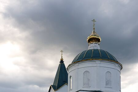 Roofs and domes of a small old church