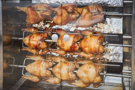 A few whole chickens are fried