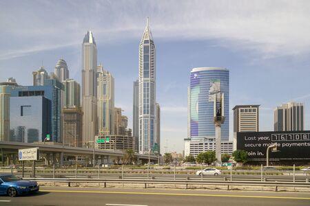 DUBAI, UAE, JANUARY 13, 2019: Beautiful modern high-rise buildings against the blue sky.