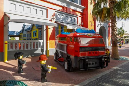 DUBAI, UAE, JANUARY 09, 2019: Fire department with firefighters and fire engine made of Lego bricks in Legoland at Dubai Parks