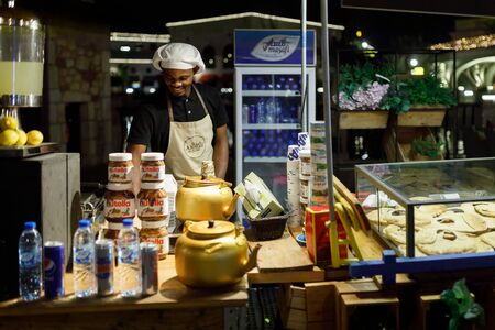 DUBAI, UAE, JANUARY 09, 2019: Street food seller on the area of the Dubai Parks.