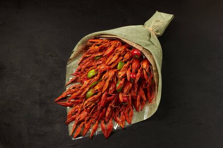 Bouquet of fresh boiled crawfish lies on a black background. Stock Photo