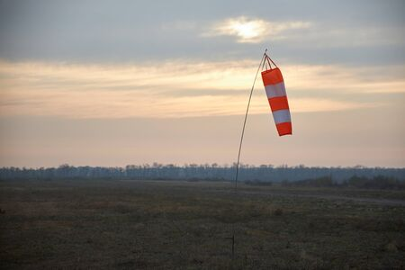 Indicator of speed and wind strength at the aerodrome in the form of a conical striped sleeve.