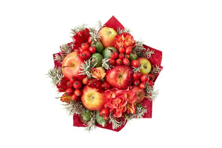 Beautiful red bright bouquet of apples, rose hips, feijoa and roses on a white background. Top view.