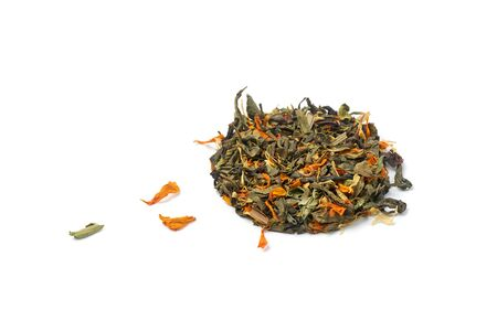 Small heap of dry healthy herbal tea with petals of medicinal plants on a white background.