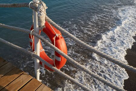 Lifebuoy with a rope is a means of saving a man drowning in the sea.