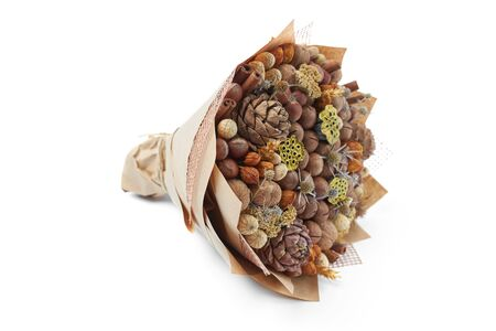 Unique bouquet of different types of nuts on a white background.