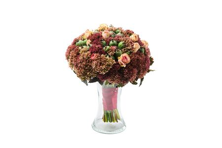 Lush bouquet of flowers and green feijoa fruits stands in a vase on a white background. Stockfoto