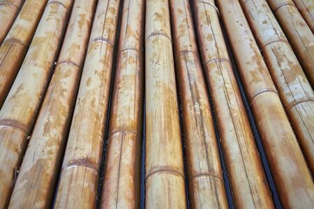 Bottom of a bamboo raft in water as a background or backdrop.