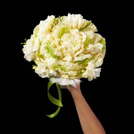 An original gift to a vegetarian in the form of a bouquet of napa cabbage. Stock fotó