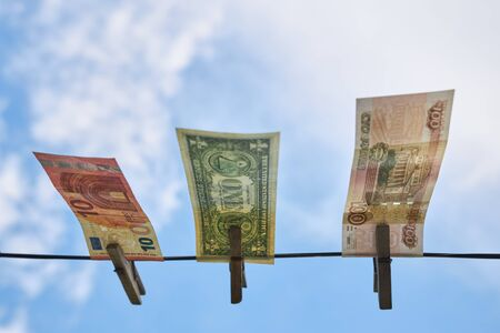Rubles, dollars and euros hang on a clothesline, bottom view. Archivio Fotografico - 147465889