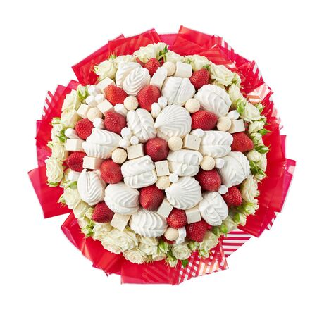 Beautiful bouquet created from white roses, marshmallows and ripe strawberries. Top view, isolated