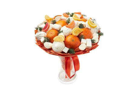 Original bouquet created from marshmallows, zephyr, marmalade and mandarins stands in a vase on a white background. Archivio Fotografico - 147465883