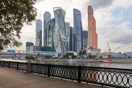 Moscow, Russia, August 21, 2019: View of a group of skyscrapers from the opposite bank of the river on a summer evening.