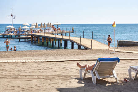 Kemer, Turkey, September 24, 2019: A small number of vacationers on a popular beach in Turkey.