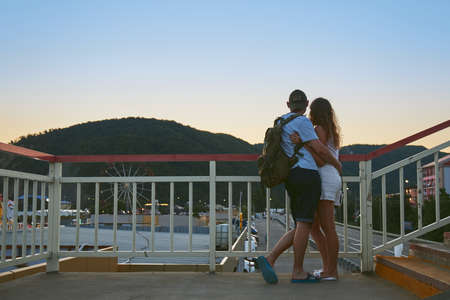 Lermontovo, Krasnodar Region, Russia, July 22, 2019: A couple of lovers stand embracing and taking in the view of a beautiful summer sunset