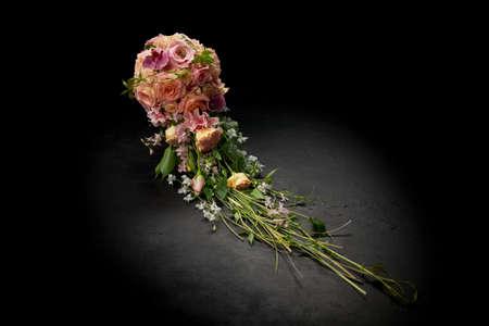Beautiful cascading bouquet on a black background. Archivio Fotografico