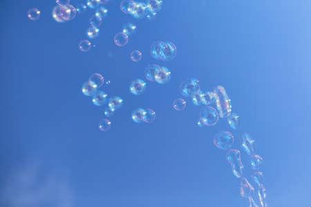 Many soap bubbles against a blue sky. Archivio Fotografico