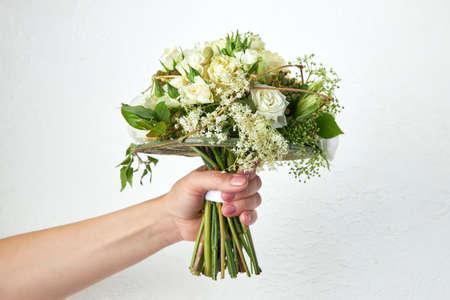 Green wedding bouquet in woman hands on white background. Archivio Fotografico