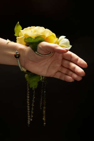 Womens accessory on the wrist as the bracelet with a large yellow flower. Archivio Fotografico