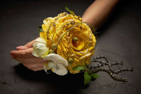 Elegant flower bracelet of the bride in the form of a glamelia from yellow rose petals.
