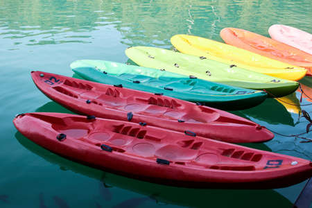 Several multi-colored plastic boats await tourists for walking.