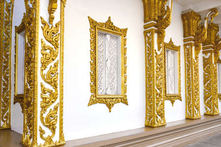 Building wall with windows decorated with oriental gold patterns.