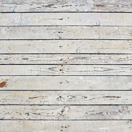 Dirty wooden boards painted with white paint as a backdrop.