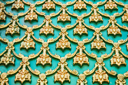 Golden oriental pattern on a green background.