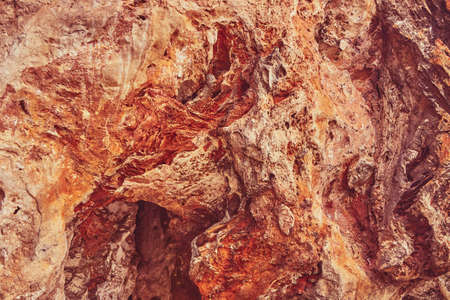 Red stone cave wall as background or backdrop.