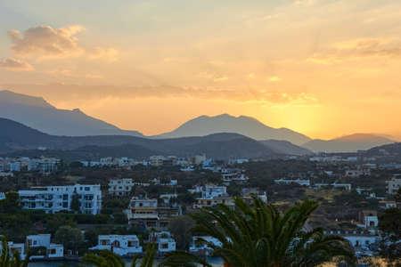 Agios Nikolaos, Greece, August 16, 2013: Sunset over the city