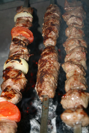 Pork and lamb shashlik and lulah kebab almost ready to eat