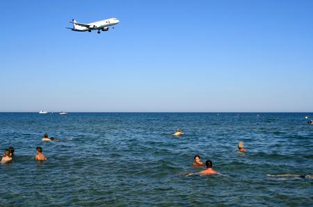 Larnaca, Cyprus, June 25th, 2017: An airplane passing over Mackenzie Beach to Larnaca International Airport