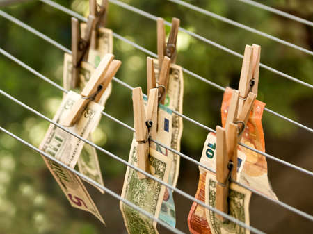 Money laundering concept: Dollar and euro banknotes hanging out to dry on clotheslines