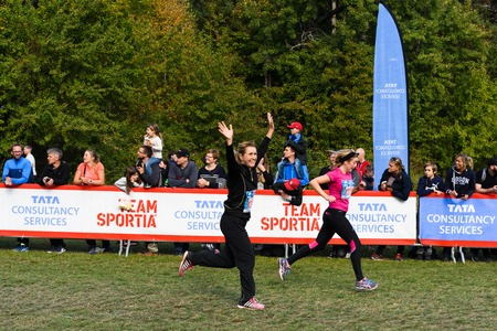 Stockholm, Sweden - September 24, 2016: Happy woman raising her hands as she crosses the finish line in the race, TCS Lidingoloppet Editorial