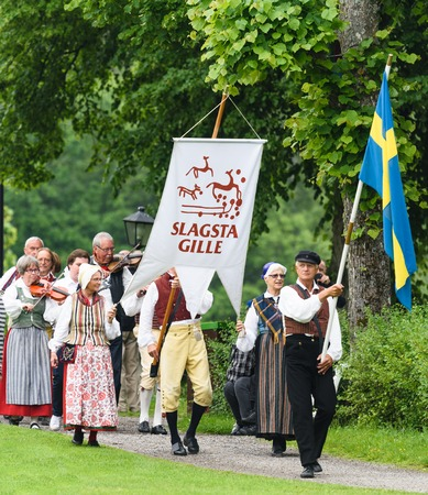 Stockholm, Sweden - June 24, 2016: Midsummer celebrations with Slagsta Gille in Hagelbyparken, botkyrka. Slagsta Gille consists of musicians and dancers who play old Swedish folk music. They starts the yearly Midsummer celebration Editorial