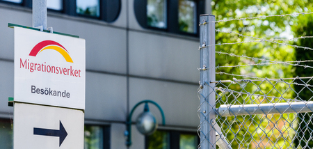 Norrkoping, Sweden - July 4, 2014: Migrationsverket, an arrow for visitors pointing to barbed wire fence. A very a symbolic picture of all refugees who have recently arrived in Sweden, the Migration Agency is the authority that considers applications from Editorial