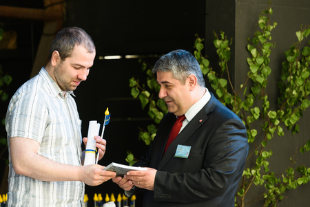 politicians: Stockholm, Sweden - June 6, 2016: Mattias Gokinan, local politicians in Botkyrka municipality hold a ceremony at the Swedish National Day, Hagelbyparken, Botkyrka and welcome the new Swedish citizen and has a dividend of welcome gifts Editorial