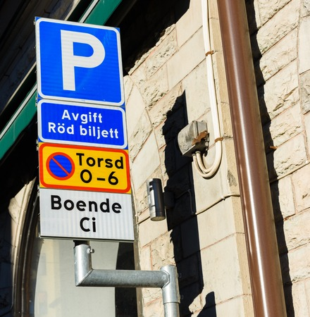 Parking provisions sign, Fee for Red ticket, Forbidden to parking Thursday between 0 am - 6 am, resident Ci Stock Photo - 63948132
