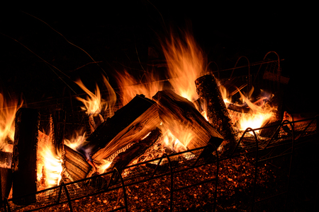 logs burning on open fire Stock Photo - 63948136